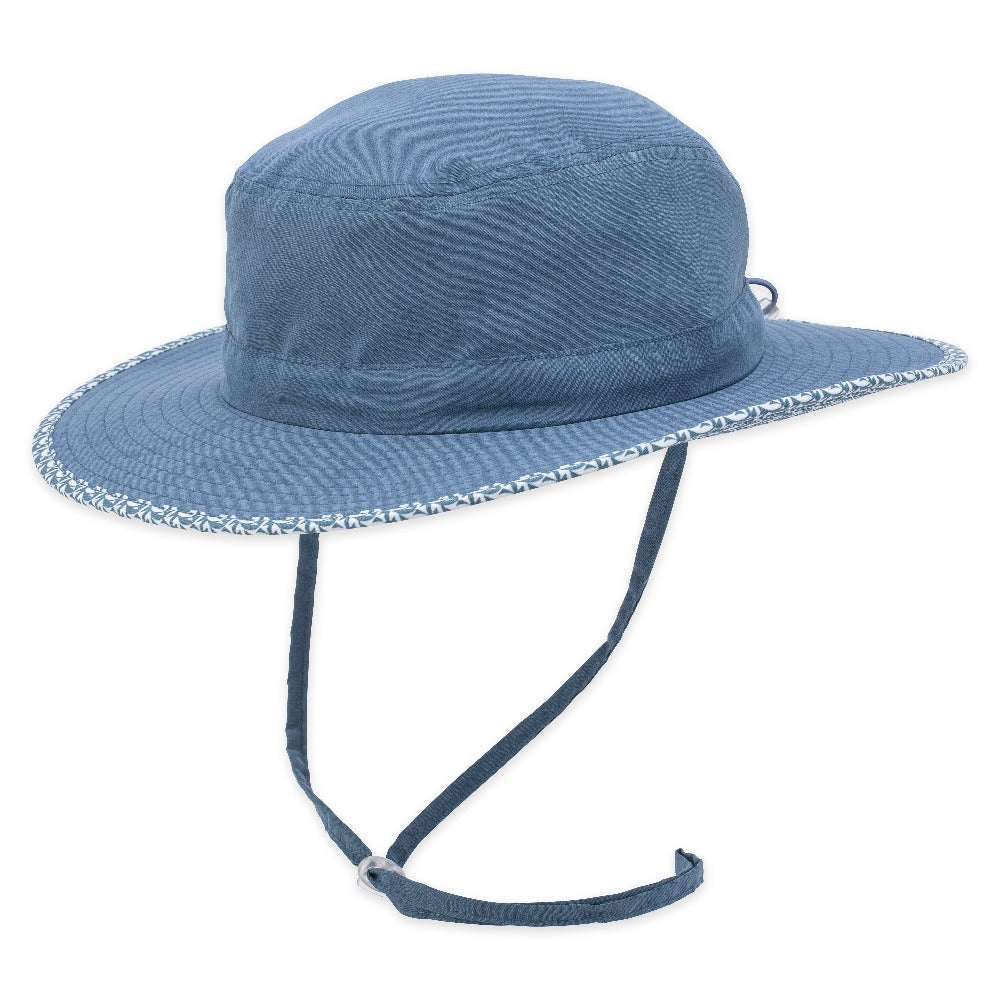 Women's Pistil Lotus Sun Hat with wide brim, pattern trim and adjustable chin cold in Indigo