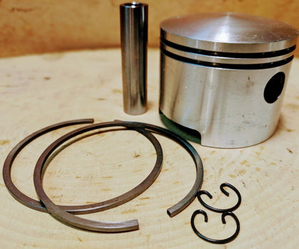 Vintage Chainsaw Pistons - www.SawSalvage.co Traverse Creek Inc.
