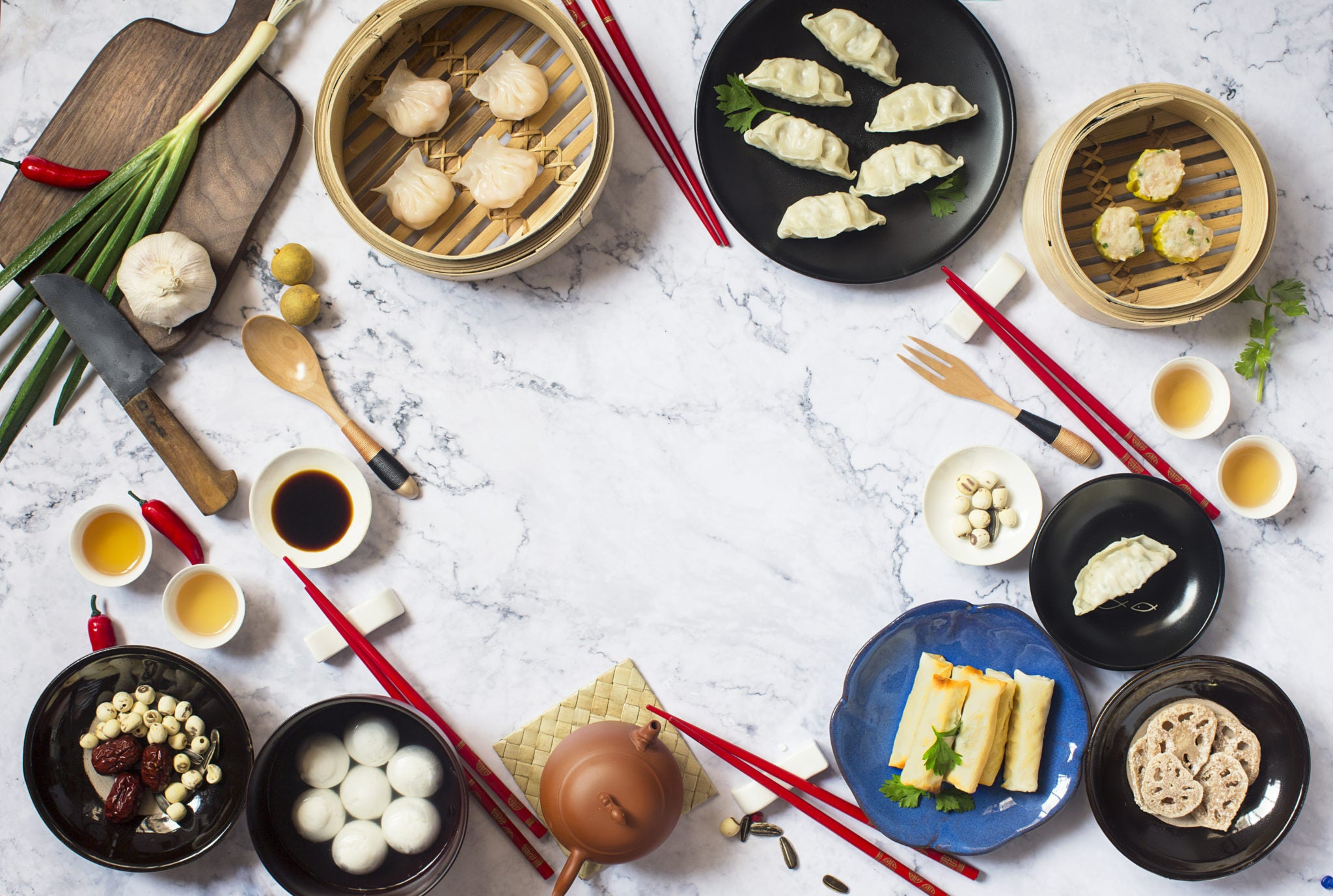 chinese dishes served on a white table for chinese new year