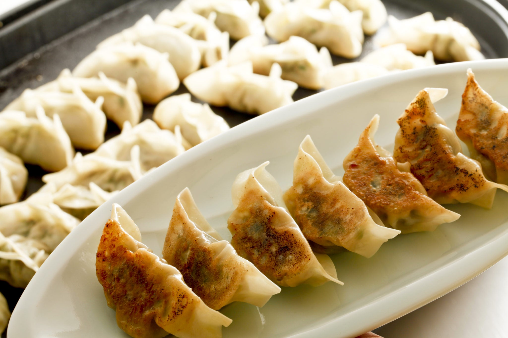 dumplings fried on a griddle for the chinese new year
