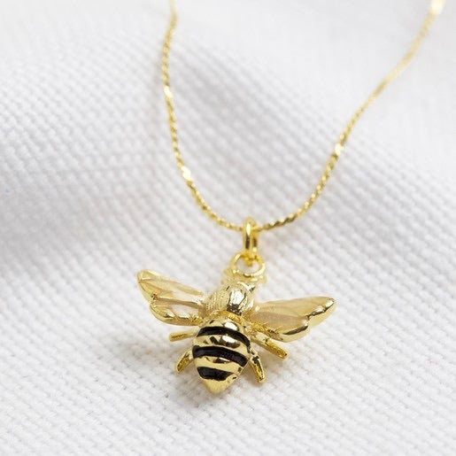 Tiny gold enamel bumble bee necklace