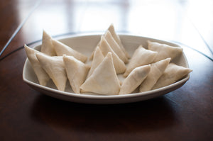 A plate of cold white samosas