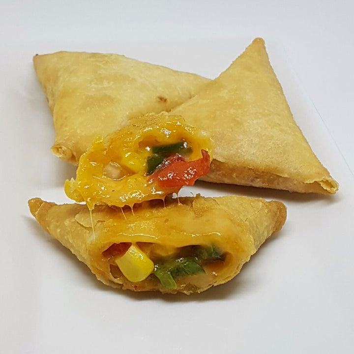 Opened samosa with peppers, corn and cheese