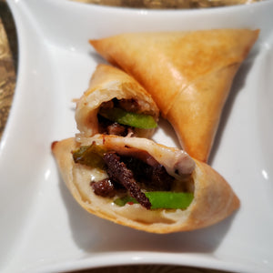 Opened samosa showing beef, peppers and cheese