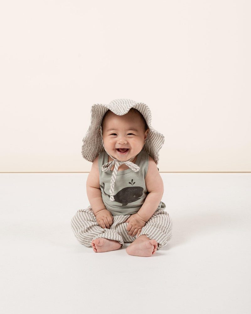 Baby in Olive Stripe Harem pant, floppy sun hat, and Rylee + Cru whale tank