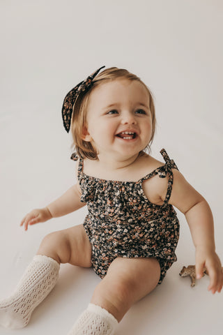 toddler wearing Jamie Kay Wanderlust print Luca Floral in the Luna Playsuit - now 20% off at Barn Chic Boutique