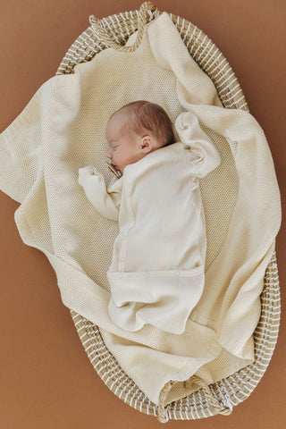 Fin & VInce Chapter 3 Solid Essentials Milk Layette Sack - baby in bassinet