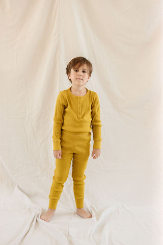Fin & Vince Chapter 3 Solid Essentials collection - young boy wearing chartreuse ribbed henley and drop needle pants