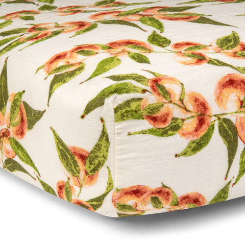 Milk Barn kids new crib sheets! 100% organic cotton crib sheet in Spring 2021 print Peaches. Product photo for Barn Chic Boutique.