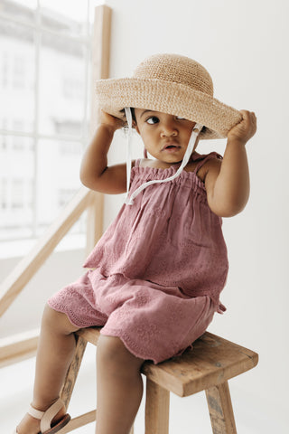 Little girl in Jamie Kay Flourish Collection Prague Blake Top and Quinn shorts with floppy hat