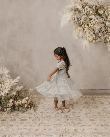 Noralee dress at Barn Chic Boutique - little girl twirling