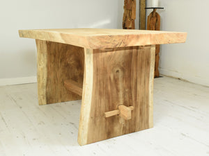 150cm Suar live edge dining table with pedestal style legs, side view.