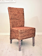Load image into Gallery viewer, Banana leaf dining chair natural.