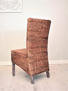 Banana leaf dining chair natural,, back view.