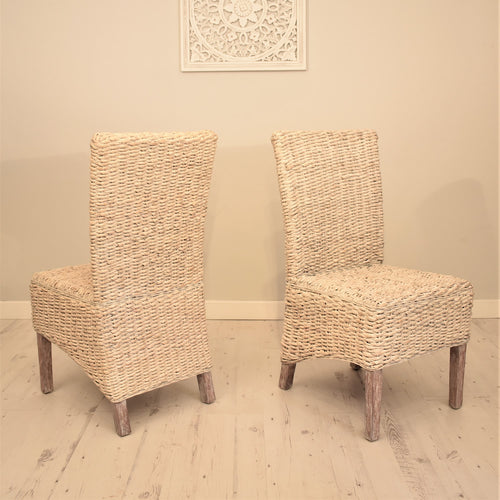 Banana leaf dining chair whitewashed.