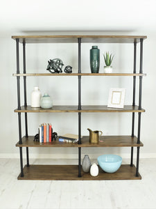 Vintage industrial style shelving unit. Items displayed on shelves.