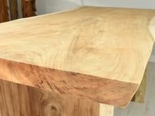 Load image into Gallery viewer, 150cm Suar live edge table with pedestal style legs, close up view.
