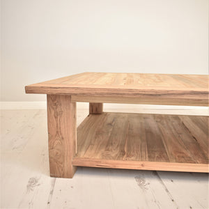 Square reclaimed teak coffee table, side view.