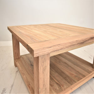 Square reclaimed teak chunky coffee table, corner view.
