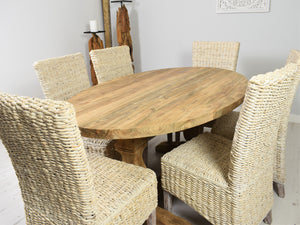160cm Reclaimed teak oval dining set with 6 whitewashed banana leaf chairs, side view.