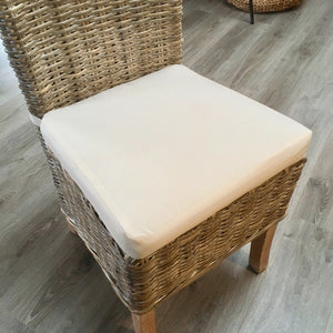 Whitewashed Kabu chair with natural cushion.