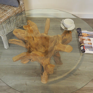 Round reclaimed teak root 100cm coffee table, view of the glass top.