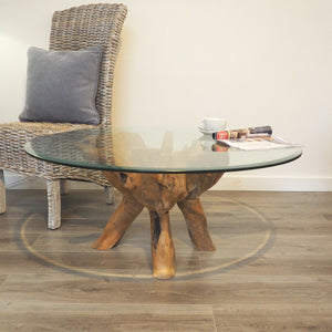 Round reclaimed teak root coffee table side view.