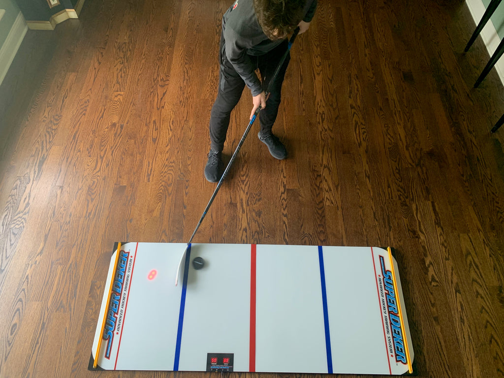 Stickandling with the ePuck Max is a great way to build wrist strength in hockey.
