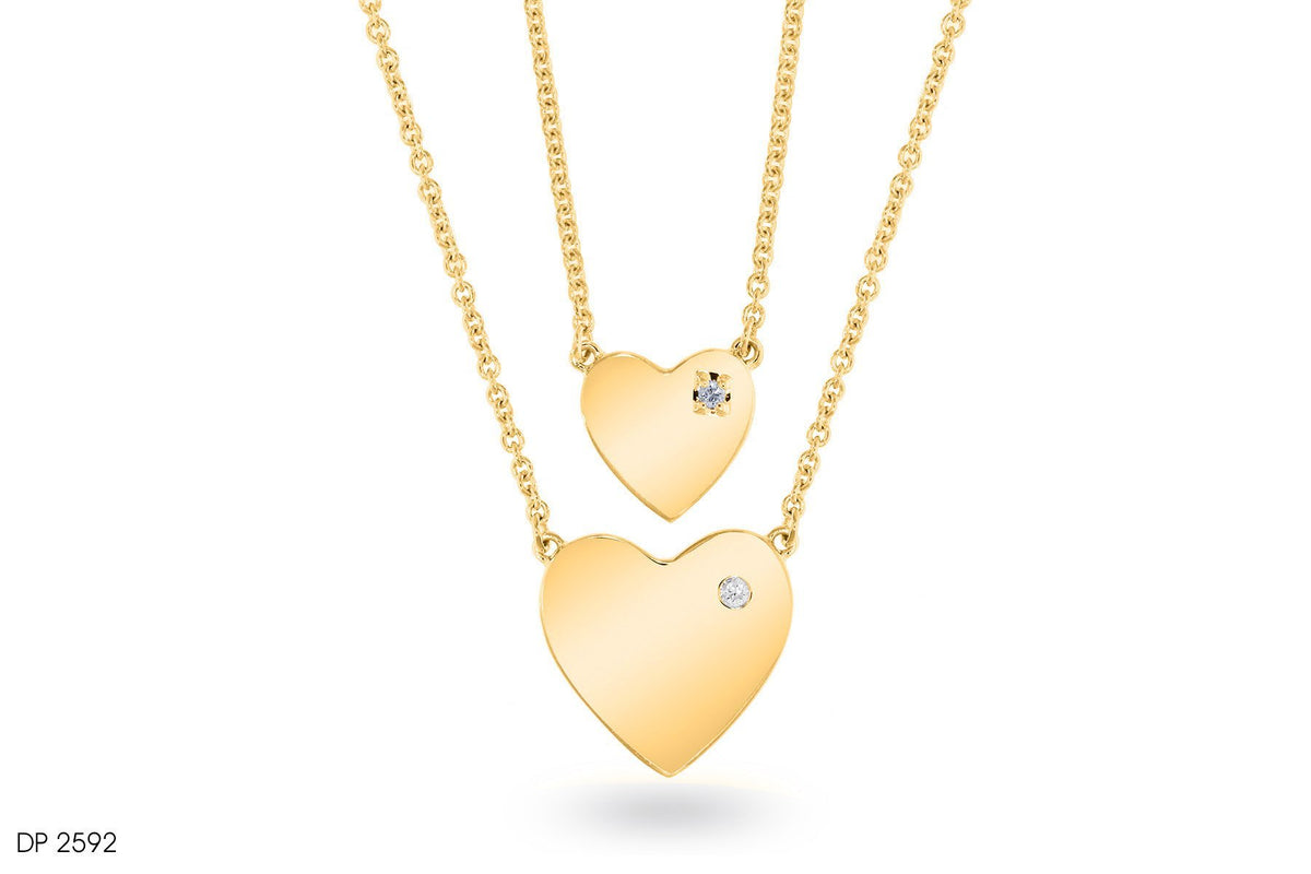 Lustrous Gold Hearts Diamond Pendant