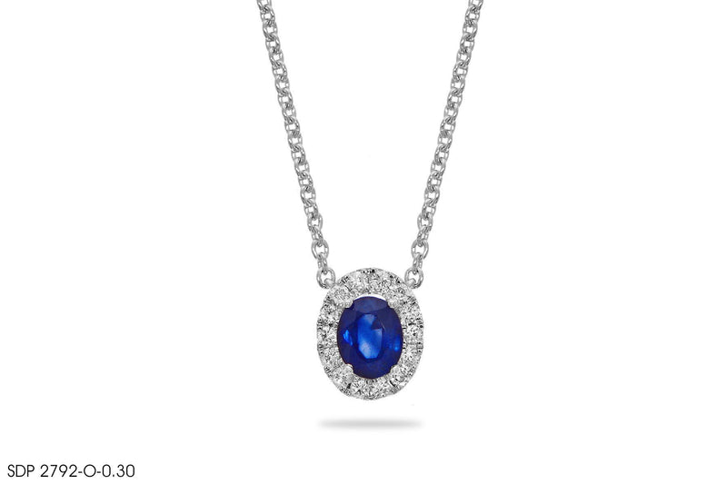 Blue Sapphire Halo Diamond Pendant In Gold