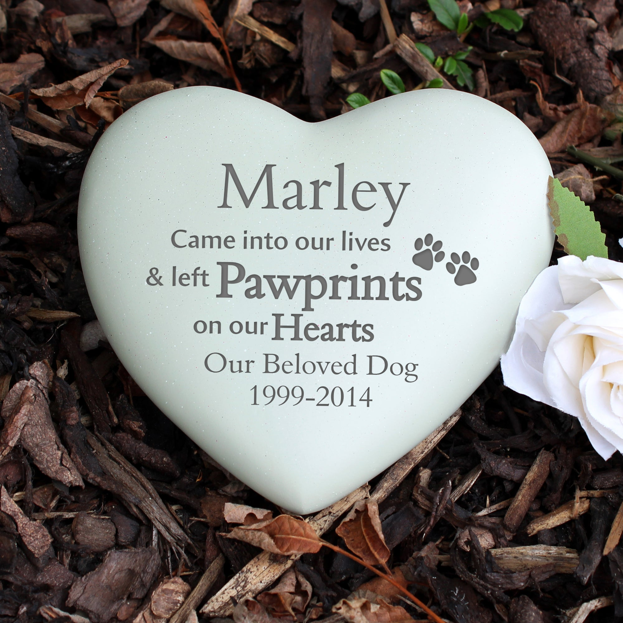 Image of a heart shaped engraved memorial stone which can be personalised for a pet cat or dog