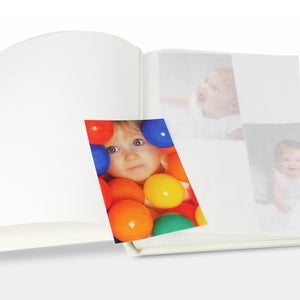 Image of the internal pages of our traditional photo album with approximately 30 tissue interleafed pages.