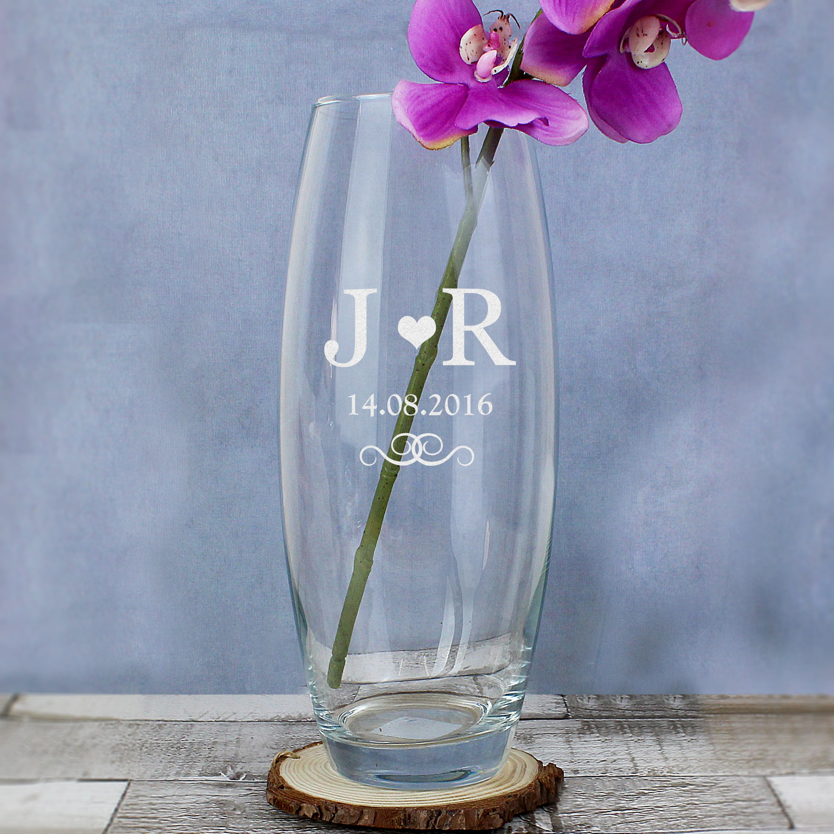Image of a monogrammed glass bullet vase which can be personalised with 2 initials and a date