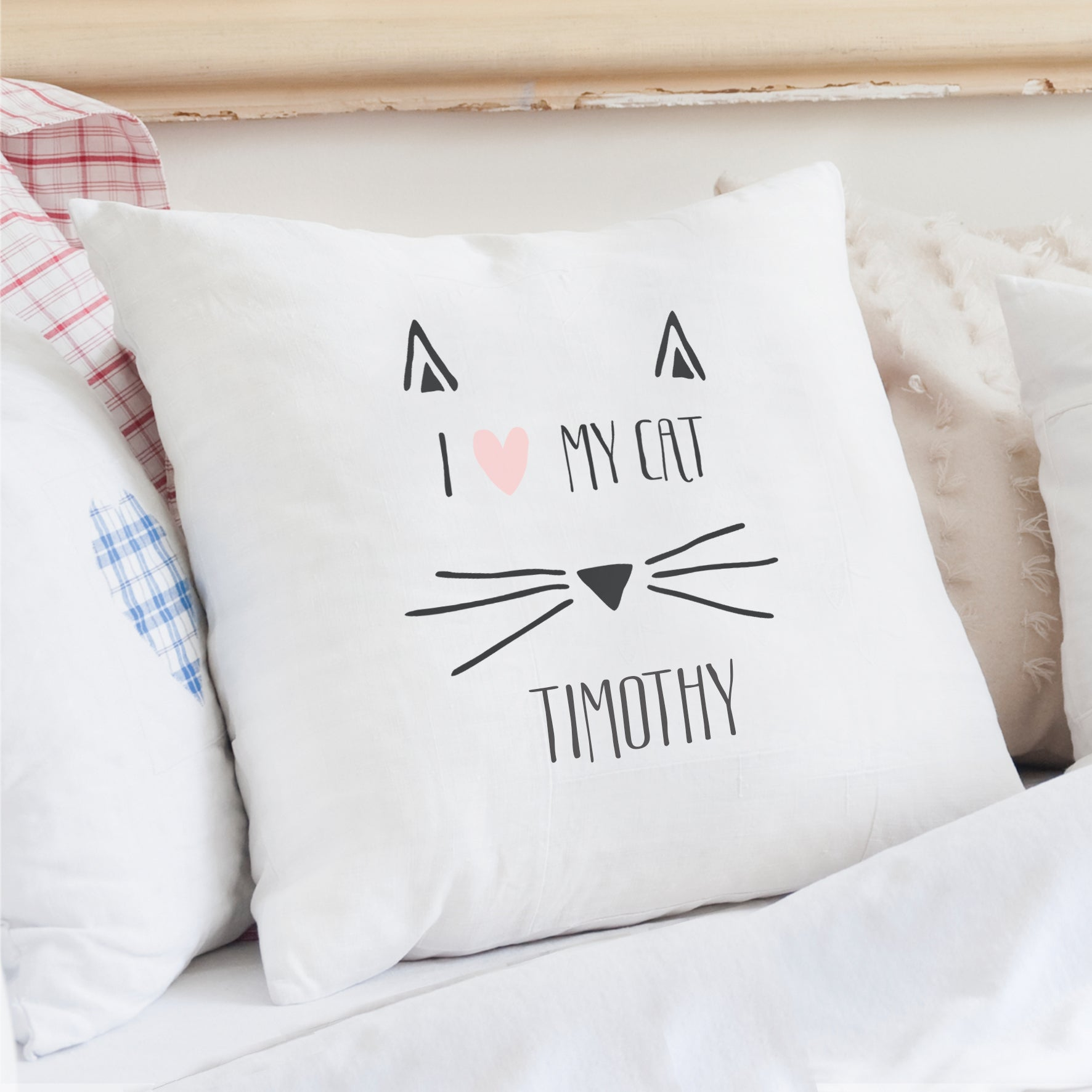 "Image of a cushion cover which can be personalised with ""I love my cat"" and a name of your choice"