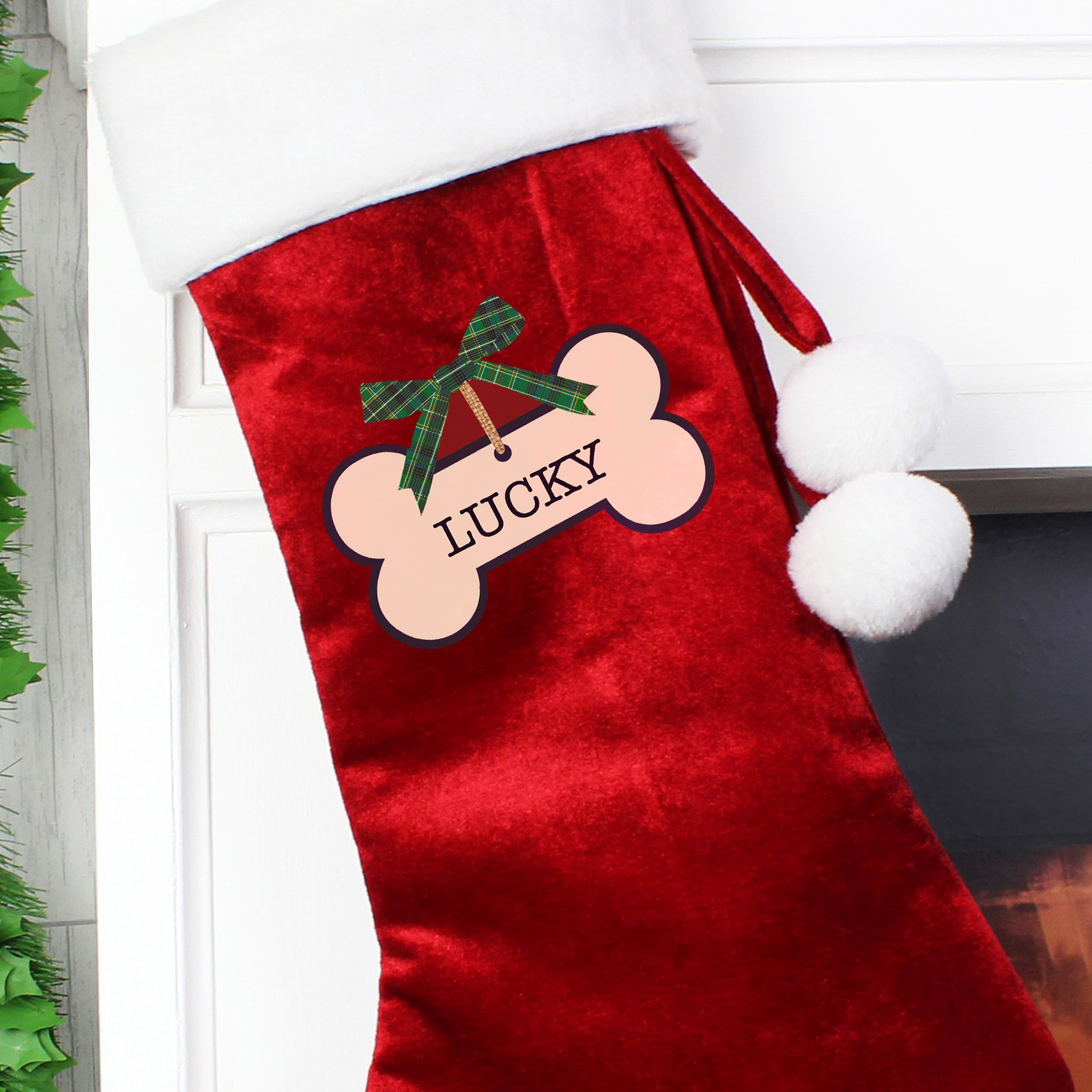 Image of a personalised red velvet Christmas stocking with a bone design for a dog