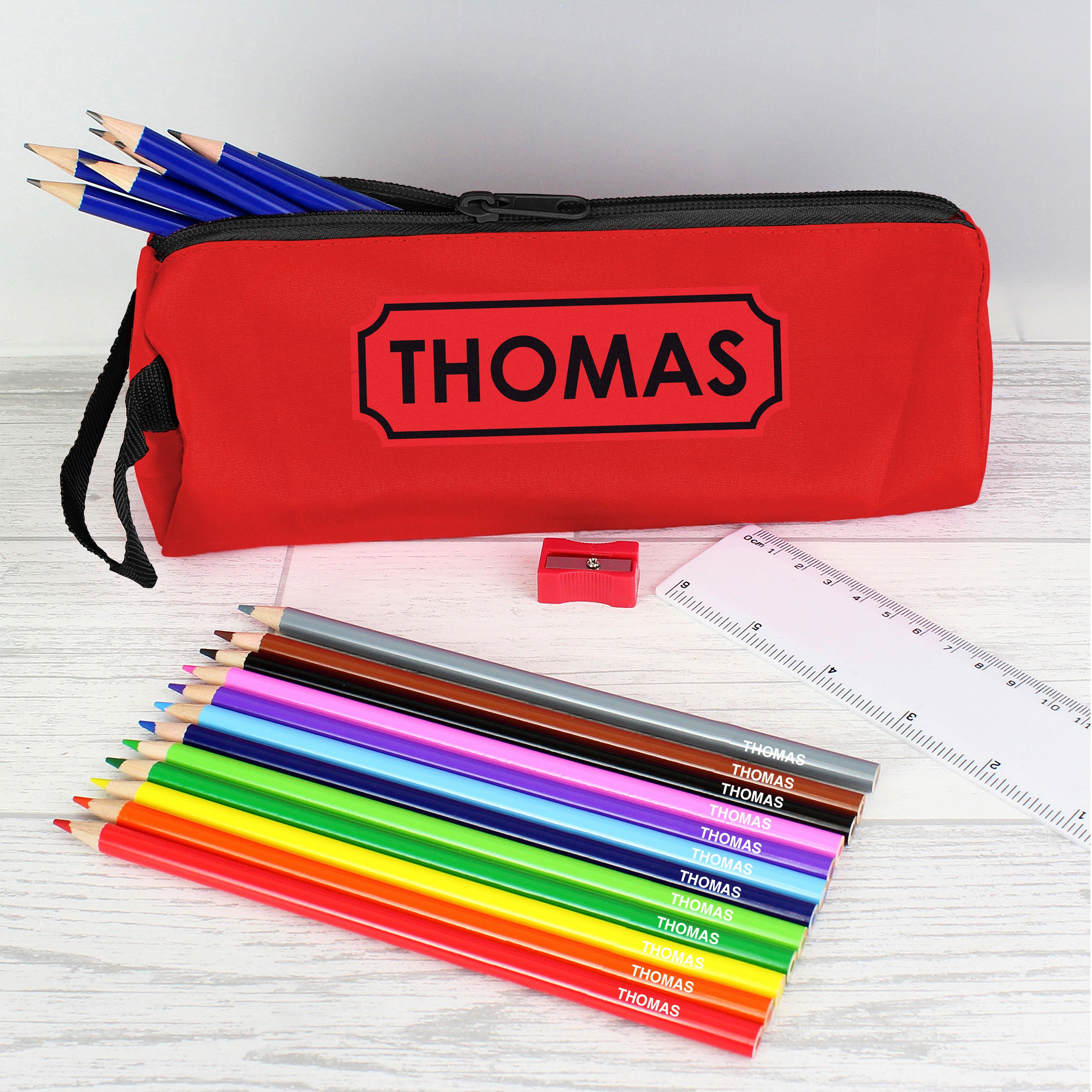 Red personalised pencil case with named colouring pencils