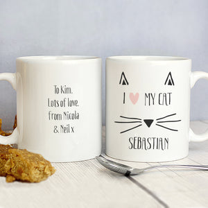 Front and rear image of a white ceramic mug with a fun cat illustration which can be personalised with a name and message of your choice