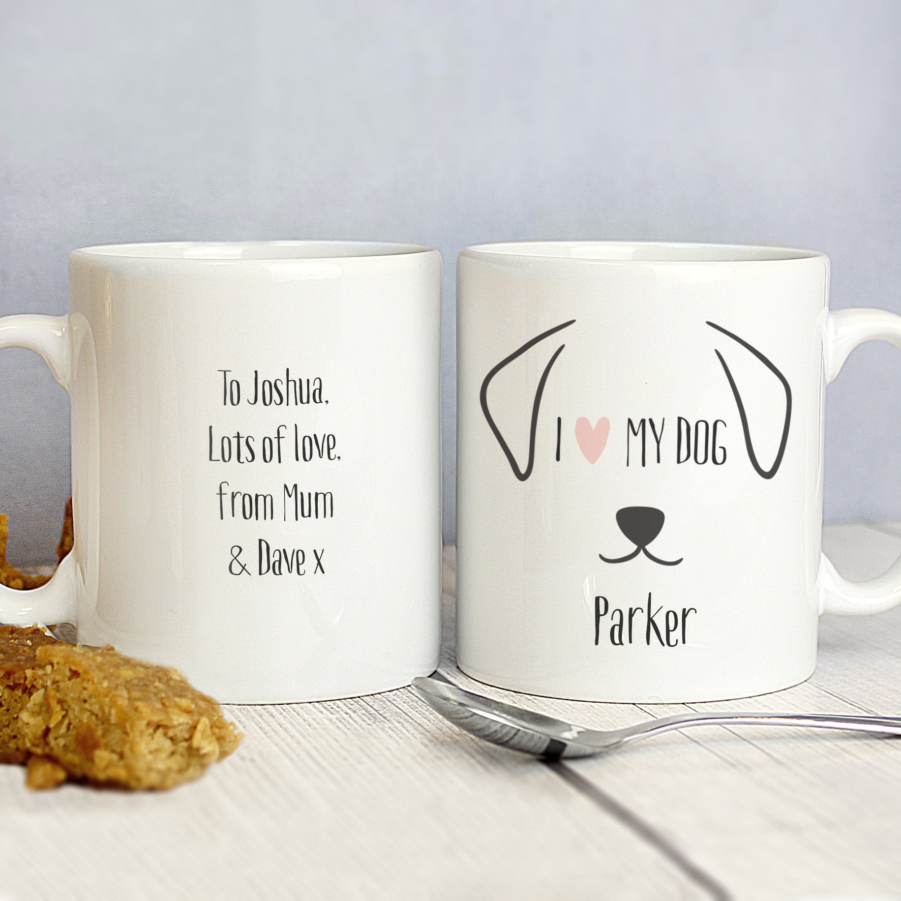 Front and back image of a white ceramic mug with a fun dog illustration that can be personalised with a dog's name and a message of your choice