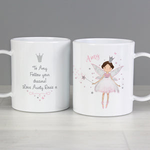 Image of a plastic BPA free childs personalised cup. The cup is white and has an image of a fairy at the front wearing a pink dress and with a silver crown and holding a wand. The plate can be personalised with a name of your choice which will be printed just above the fairy on the left side in a pink cursive font.  The back of the cup features a silver glitter crown and beneath it you can add your own message over 4 lines which will be printed in a delicate black font.
