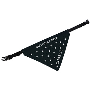Image of a personalised black dog bandana with small white paw prints
