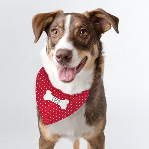 Image of a dog wearing a red polka dot bandana which can be personalised with a name