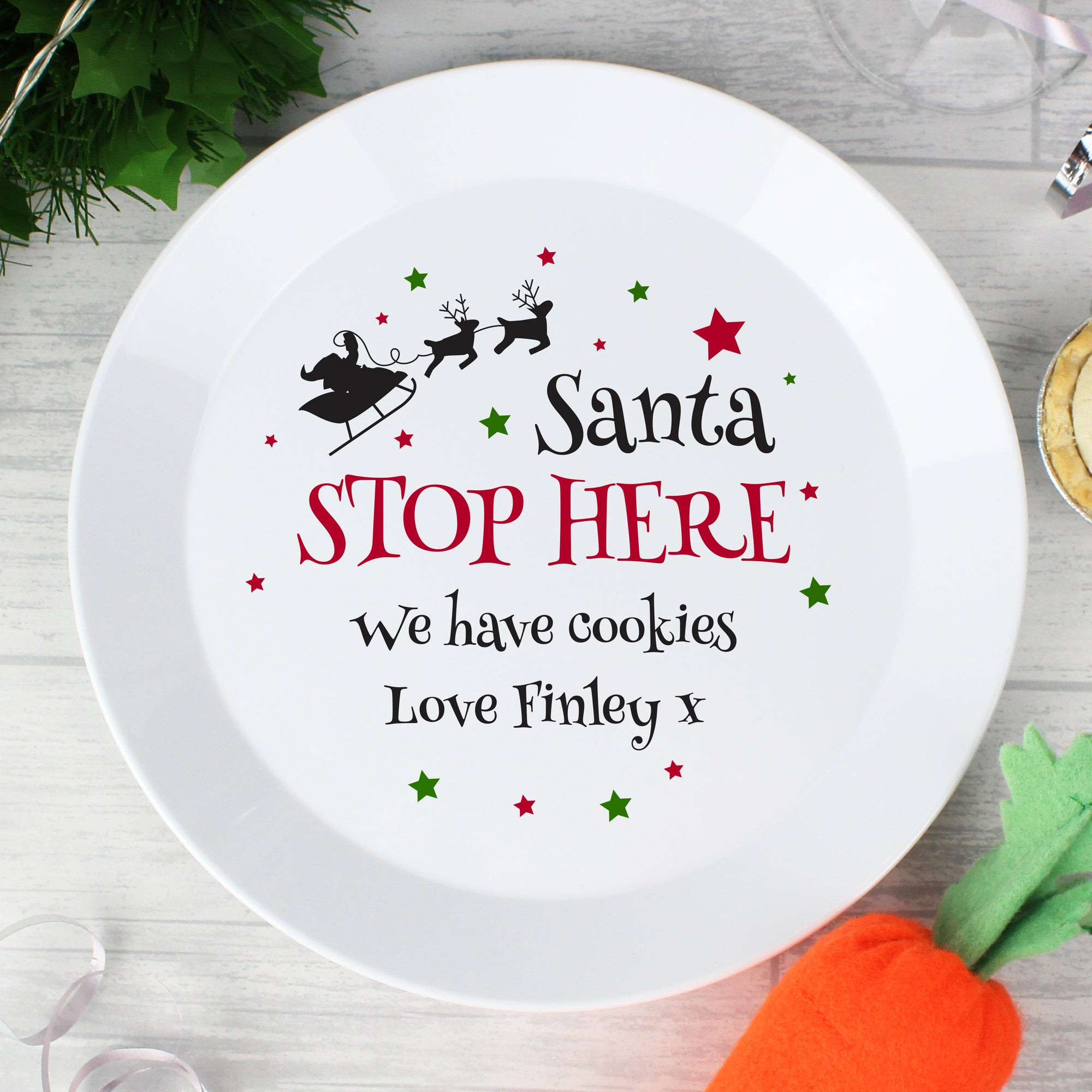 Personalised Christmas Eve Plate featuring the wording 'Santa STOP HERE' in black and red which can then be personalised with your own message over 2 lines of up to 20 characters per line. Made from white shatter-proof BPA free plastic.