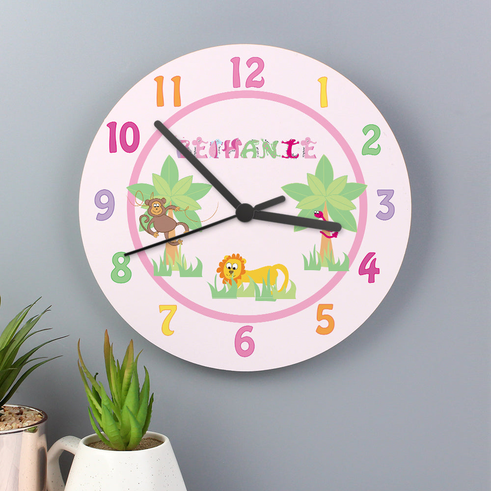 Personalised Clock for a girls bedroom made from fine bone china and featuring an alphabet made from animal characters