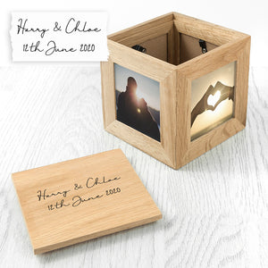 Image of an oak photo cube and keepsake box. You can put a photo into each of the four sides of the cube and the lid of the cube can be engraved with your own handwritten message. The inside of the box can be used to store small mementos.