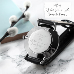 Image of the back of a watch engraved with your own handwriting or the handwriting of a loved one. The watch has a white dial with a silver case and silver details on the watch face, and a black leather strap and part of the Elie Beaumont range of ladies watches.