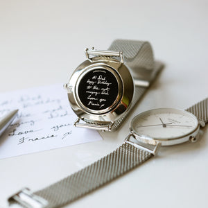 Front and rear image of a men's watch that can be engraved on the back with your own handwriting. The watch is made by Architect London and has a large white face and a stainless steel mesh strap. The rear of the watch can be engraved with your message written in your own handwriting.
