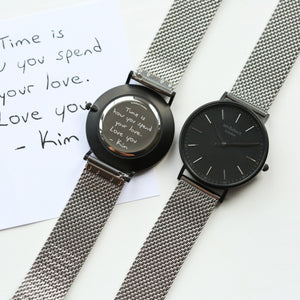 Front and rear image of a men's watch that can be engraved on the back with your own handwriting. The watch is made by Architect London and has a large black face and a stainless steel mesh strap. The rear of the watch can be engraved with your message written in your own handwriting.