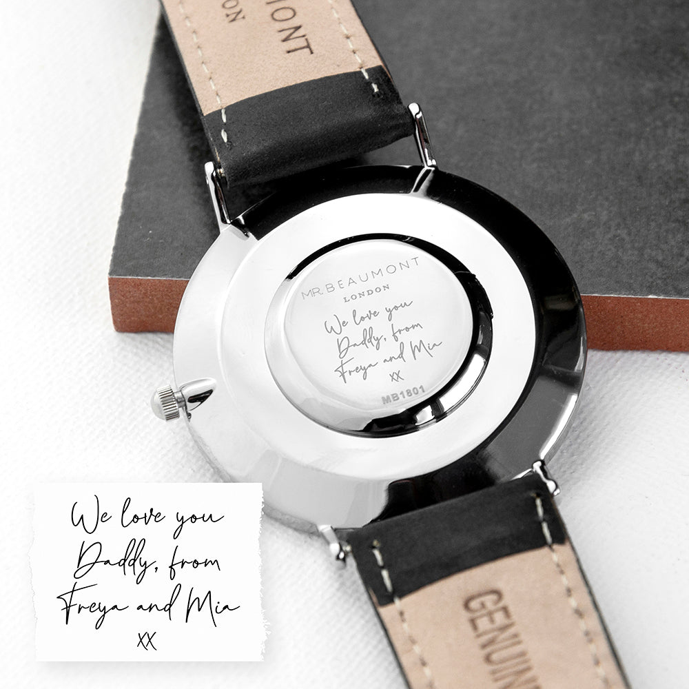 Image of the back of a watch engraved with your own handwriting or the handwriting of a loved one. The watch has a white dial with a silver case and silver details on the watch face, and a black leather strap and part of the Mr Beaumont range of men's watches by Elie Beaumont.