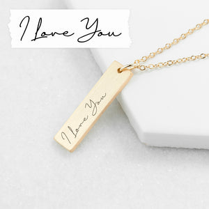 A gold plated necklace with a bar pendant that can be engraved with your own handwritten note or the writing of a loved one.