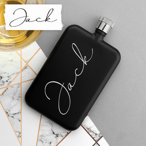 Image of a personalised black slimline hip flask with a screw top lid that can be personalised with your own handwritten message printed in white.